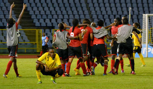 Photo: Trinidad and Tobago celebrates its Caribbean Cup final win over Jamaica. (Courtesy Jinelle James/WOLF)