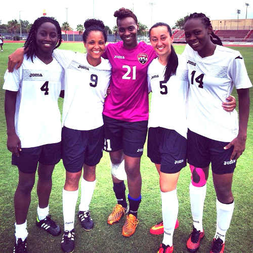 Photo: Trinidad and Tobago captain Maylee Attin-johnson (second from left) and Arin King (second from right) pose during the team's pre-tournament camp in Houston. (Courtesy TTFA Media)