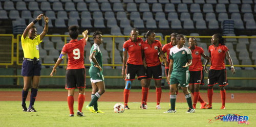 Photo: Trinidad and Tobago captain Maylee Attin-Johnson (second from left) helps set a defensive wall against St Kitts and Nevis. (Courtesy Jinelle James/Wired868)