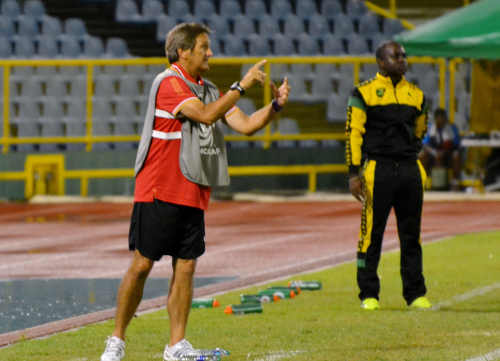 Photo: Trinidad and Tobago coach Randy Waldrum (left) makes a point while Jamaican coach Merron Gordon looks on. (Courtesy Jinelle James/WOLF)