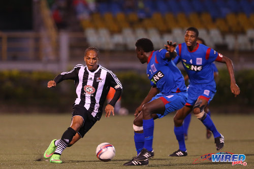 Photo: Central FC attacker Nathaniel Garcia (left) runs at St Ann's Rangers defenders Trevin Latapy (centre) and Jelani Peters during 2014/15 Pro League action. (Courtesy Allan V Crane/Wired868)