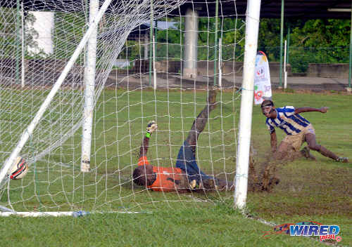 Photo: Shiva Boys goalkeeper Nicholson Gordon (left) is beaten while St Mary's College player Rickel Dixon looks on. Shiva Boys handed St Mary's its first defeat of the season at Guaracara Park. (Courtesy Wired868)