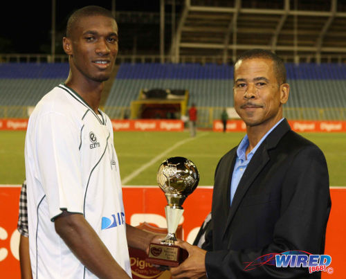 Photo: W Connection attacker Hashim Arcia (left) collects the 2013 Charity Shield MVP award from Pro League CEO Dexter Skeene. (Courtesy Wired868)