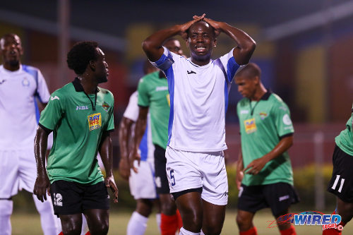 Photo: Police FC defender Anton Hutchinson (centre) reacts after a missed opportunity against San Juan Jabloteh in a Digicel Pro League encounter on Friday night. (Courtesy Allan V Crane/Wired868)