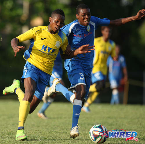 Photo: Presentation College (San Fernando) defender Kori Cupid (right) tries to keep up with Shiva Boys attacker Levi Garcia. Garcia scored a decisive penalty kick today against St Benedict's College. (Courtesy Allan V Crane/Wired868)