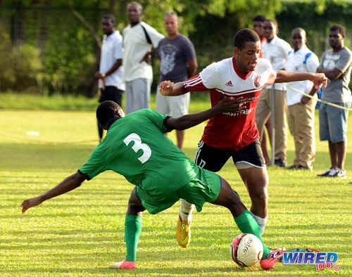 Photo: St Anthony's College winger Raheem Borde (right) skips past San Juan North defender Hakeem Wilson. (Courtesy Wired868)