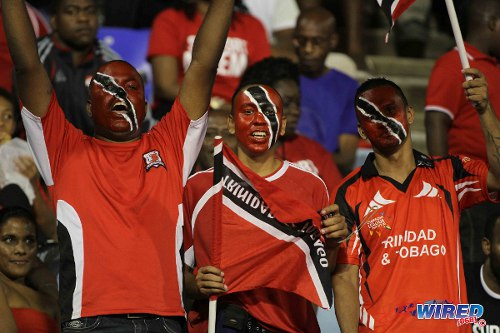 Photo: Trinidad and Tobago football supporters get behind their team during last year's international friendly against New Zealand. (Courtesy Allan V Crane/Wired868)