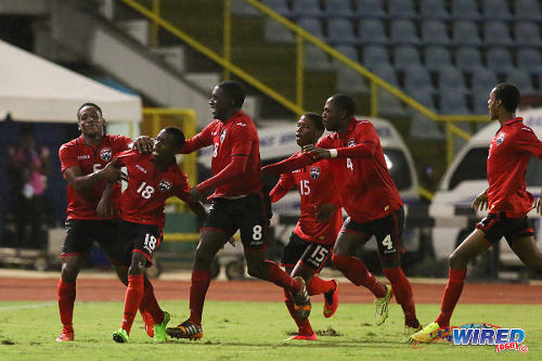 Photo: Trinidad and Tobago playmaker Jabari Mitchell (second from left) celebrates the winning goal against Suriname during the Under-20 Caribbean Cup. (Courtesy Allan V Crane/Wired868)