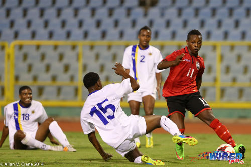 Photo: Trinidad and Tobago winger Levi Garcia (right) bamboozles the Curaçao defence during a 2014 U-20 Caribbean Cup fixture. Garcia, 18, is still eligible to represent the Trinidad and Tobago National Under-20 Team. (Courtesy Allan V Crane/Wired868)