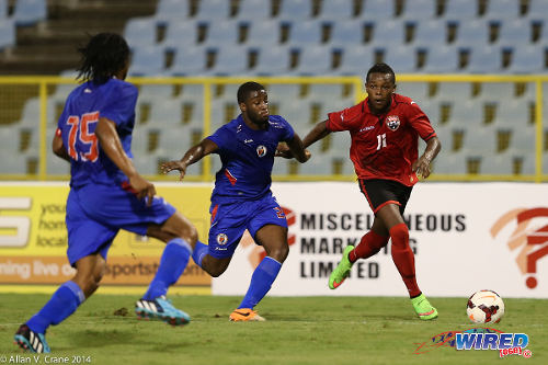 Photo: Trinidad and Tobago winger Levi Garcia (right) prepares to create the opening goal while Haiti defenders Stephane Lambese (centre) and Jean Jean-Baptiste look on. (Courtesy Allan V Crane/Wired868)