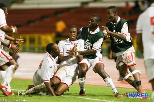 Photo: Trinidad and Tobago national under-20 defender Josiah Trimmingham (centre) celebrates his role in a late equaliser against Cuba during the Caribbean tournament. From right are his teammates Jabari Mitchell, Neveal Hackshaw and Jesus Perez. (Courtesy Allan V Crane/Wired868)