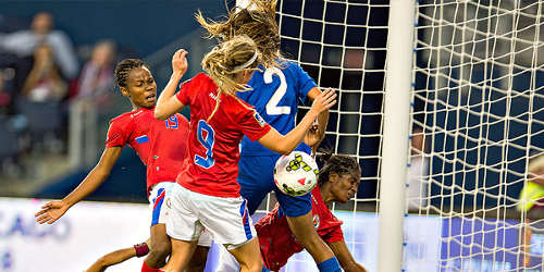 Photo: Haiti forward Lindsay Zullo (number 9) bundles the ball over the line for the winning item against Guatemala in Women's World Cup qualifying action in Kansas City. (Courtesy CONCACAF)