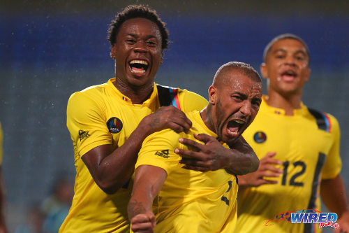 Photo: Antigua and Barbuda midfielder Joshua Parker (centre) celebrates his winner against St Lucia last Wednesday with teammates Quinton Griffith (left) and Nathaniel Jarvis. Parker, Griffith and Jarvis play professionally in the United States, Slovakia and England respectively. (Courtesy Allan V Crane/Wired868)