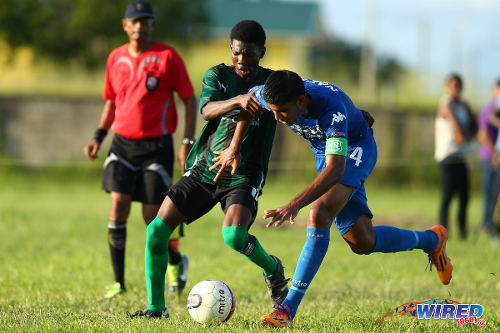 Photo Naparima College captain and defender Amritt Gildharry (right) tries to keep possession from Carapichaima East Secondary midfielder Kerwin Mitchell in SSFL Premier Division action. (Courtesy Allan V Crane/Wired868)