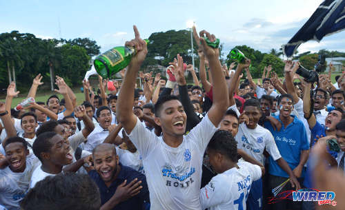 Photo: Naparima College captain Amritt  Gildharry (centre) celebrates the school's 2014 SSFL Premier Division success. (Courtesy DP Images/Wired868)