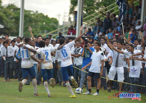 Photo: Crown the champions! Naparima College players (from left) Shane Sandy, Nicholas Thomas and Martieon Watson celebrate another goal during their 6-0 SSFL Premier Division romp over Shiva Boys HC. (Courtesy DP Images/Wired868)