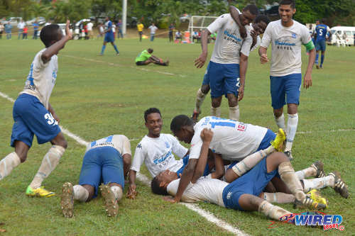 Photo: Naparima College scorer Jared Dass (bottom) is congratulated by his teammates during their 6-0 win over Shiva Boys HC in the closing SSFL Premier Division fixture at Lewis Street, San Fernando. (Courtesy DP Images/Wired868)