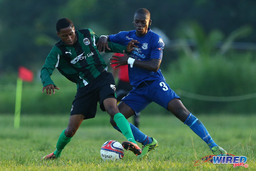 Photo: Carapichaima East midfielder Darreon Thomas (left) tries to hold off Naparima College left back Khris Stroud during SSFL Premier Division action. (Courtesy Allan V Crane/Wired868)