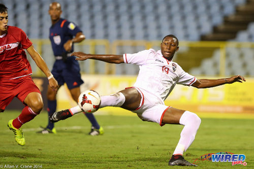 Photo: Trinidad and Tobago National Under-20 forward Nicholas Dillon goes for goal during the 2014 Under-20 Caribbean Cup. (Courtesy Allan V Crane/Wired868)