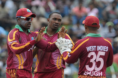 Photo: West Indies cricketers Dwayne Bravo (centre), brother Darren Bravo (left) and Carlton Baugh during a previous tour, (Copyright AFP 2014/Lakruwan Wanniarachchi)