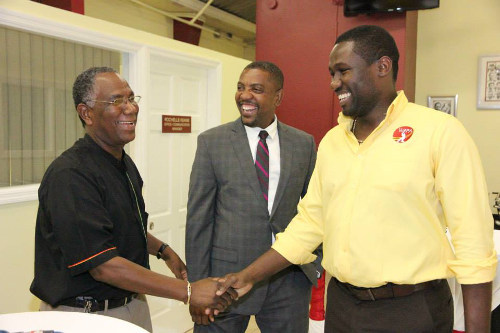 Photo: WIPA president Wavell Hinds (right) is congratulated by ex-Jamaica Cricket Association (JCA) president Lyndel Wright (left) while WICB president Dave Cameron looks on at the opening of WIPA's office in Jamaica last month. (Courtesy WIPA)