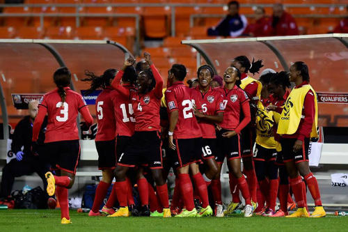 "Photo: The ""Women Soca Warriors"" enjoy a good result during the 2014 CONCACAF Championship. (Courtesy CONCACAF)"