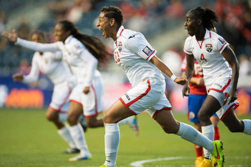 Photo: Trinidad and Tobago defender Lauryn Hutchinson (centre) screams for joy after scoring against Costa Rica in the 2014 Women's CONCACAF Championship semifinal. At right is defender Rhea Belgrave. (Courtesy CONCACAF)