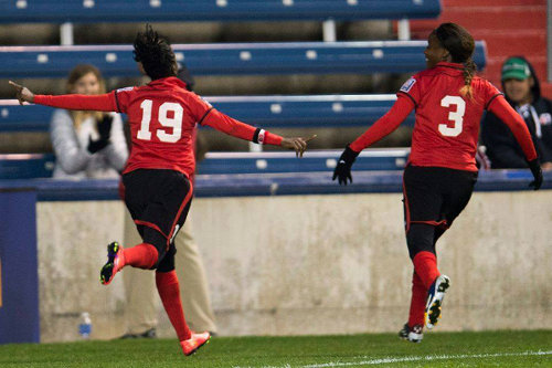 "Photo: Trinidad and Tobago goal scorer Kennya ""Yaya"" Cordner (left) and Mariah Shade celebrate the decisive goal against Haiti in Chicago during the 2014 CONCACAF Championship. (Courtesy TTFA Media)"