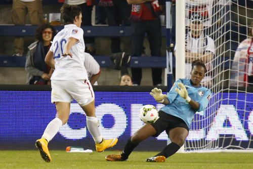 Photo: Trinidad and Tobago goalkeeper Kimika Forbes (right) makes a crucial second half save from United States' record goal scorer Abby Wambach in Women's World Cup qualifying action in Kansas City. (Courtesy Kyle Rivas/AFP)