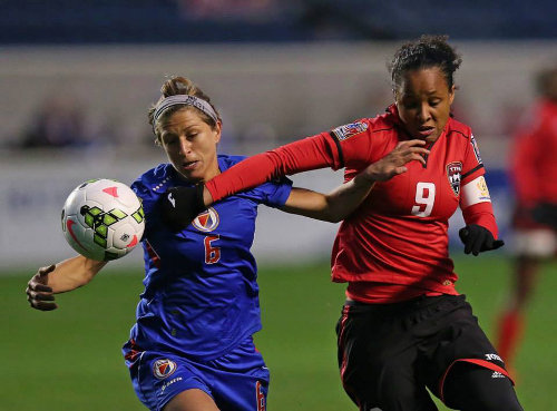 Photo: Trinidad and Tobago captain and midfielder Maylee Attin-Johnson (right) battles for the ball with Haiti attacker Kimberly Boulos. (Courtesy TTFA Media)