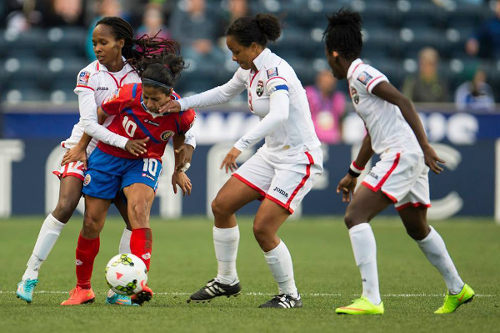 Photo: Trinidad and Tobago players (from left) Ahkeela Mollon, Maylee Attin-Johnson and Kennya Cordner try to close down Costa Rica playmaker and captain Shirley Cruz during the 2014 Women's CONCACAF Championship semifinal. (Courtesy CONCACAF)