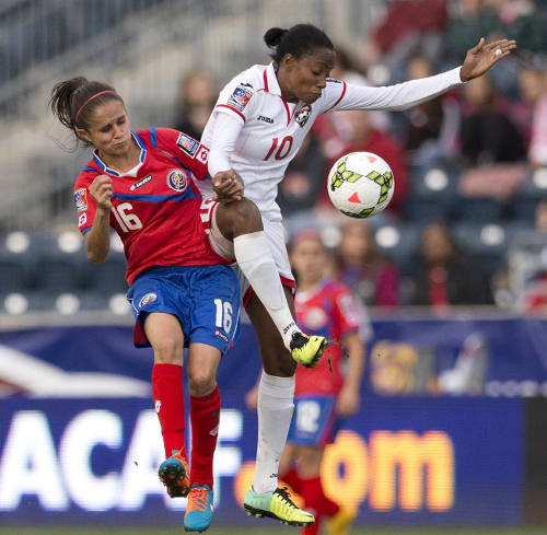 Photo: Trinidad and Tobago attacker Tasha St Louis (right) keeps the ball away from Costa Rica midfielder Katherine Alvarado during the 2014 CONCACAF Women's Championship semifinals in Chester, Pennsylvania. (Copyright Mitchell Leff/AFP 2014)