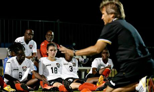 Photo: Trinidad and Tobago head coach Randy Waldrum (right) speaks to his players during a practice session in the United States in 2014. (Courtesy TTFA Media)