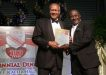"""Photo: Former Trinidad and Tobago stand-out player and coach Everald """"Gally"""" Cummings (right) is recognised by former President Maxwell Richards at the TTFF Centennial function."""