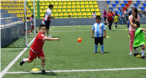 Photo: Marcelo (left), a young participant, shows off his throwing ability. (Courtesy Juliet Solomon)
