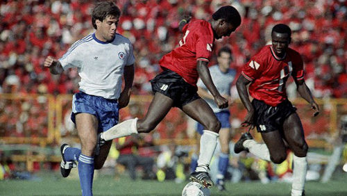 Photo: Trinidad and Tobago midfield maestro Russell Latapy (centre) tries to evade United States defender Paul Caligiuri (left) while Philbert Jones looks on at the Port of Spain National Stadium.