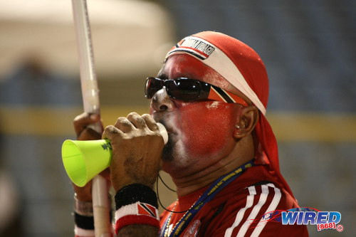 "Photo: Soca Warrior fan Joey ""Posh"" Richardson sounds the alarm. (Courtesy Wired868.com)"