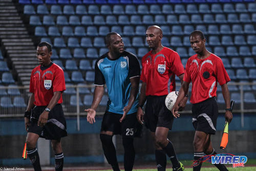 Photo: WASA striker and Trinidad and Tobago legend Stern John (centre) has a word with referee Neal Brizan. (Courtesy Sinead Peters/Wired868)