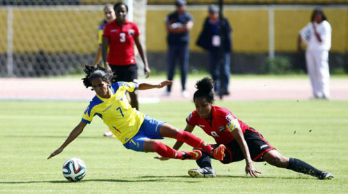 Photo: Trinidad and Tobago captain Maylee Attin-Johnson (right) chops down Ecuador attacker Ingrid Rodriguez during the 2015 FIFA Women's World Cup play off first leg in Quito. (Courtesy TTFA Media)