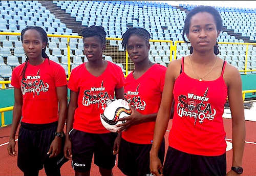 Photo: Trinidad and Tobago national senior team women (from left) Ahkeela Mollon, Khadisha Debesette, Khadidra Debessette and Dernelle Mascall pose with their TTFA supporter tee-shirts. (Courtesy TTFA Media)