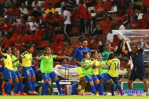 Photo: Ecuador goal scorer Monica Quinteros (second from right) celebrates her historic strike with her squad in Port of Spain. (Courtesy Allan V Crane/Wired868)