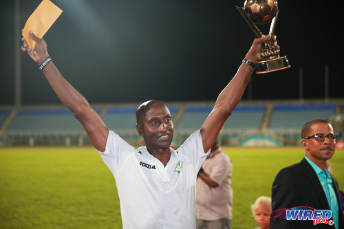 Photo: San Juan Jabloteh coach Keith Jeffrey (left) celebrates with the Best Coach trophy from the Toyota Classic competition. Looking on is Pro League CEO Dexter Skeene. (Courtesy Allan V Crane/Wired868)