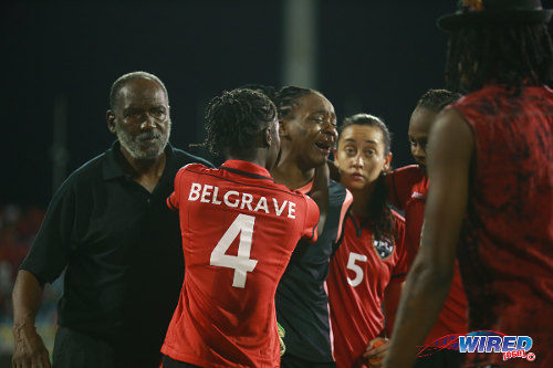 Photo: Distraught Trinidad and Tobago goalkeeper Kimika Forbes (centre) is helped to the dressing room by (from left) assistant coach Lincoln Phillips, Rhea Belgrave and Arin King after their 1-0 World Cup qualifying loss to Ecuador in Port of Spain. (Courtesy Allan V Crane/Wired868)