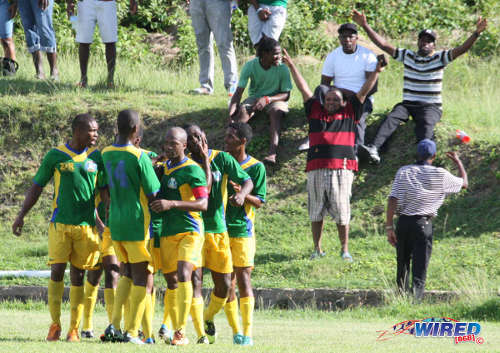 Photo: Guaya United celebrates a goal from Russell Alfred (second from right) during a 2013 Super League clash with Westside Superstarz. (Courtesy Wired868)
