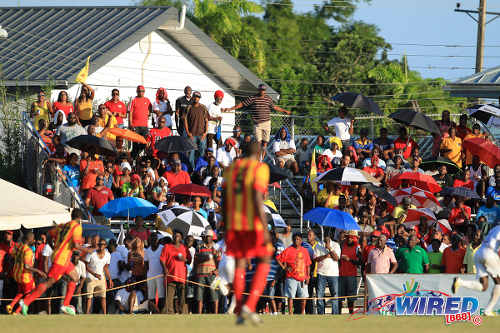 Photo: Point Fortin Civic defender Andre Ettienne had the community behind him in the club's return to the Pro League in 2013. Mahaica Oval is the only community ground in use in the TT Pro League. (Courtesy Allan V Crane/Wired868)