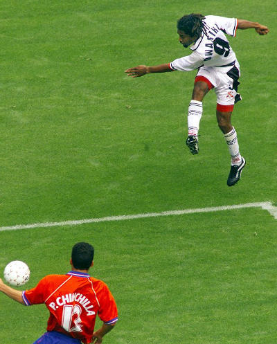 Photo: Trinidad and Tobago attacker Arnold Dwarika (top) drives home his country's opening goal in the 2000 CONCACAF Gold Cup quarter-final against Costa Rica. Dwarika is a former Joe Public standout and SSFL champion with Malick Secondary. (Copyright AFP 2015)