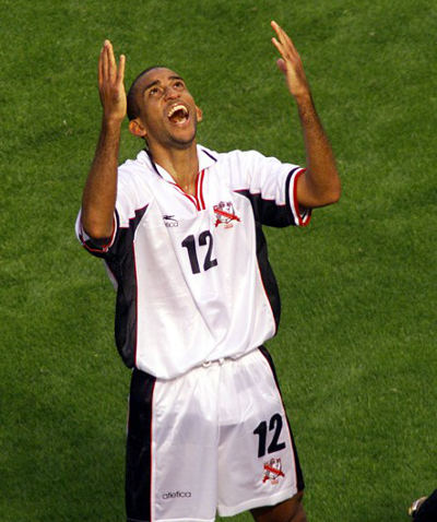Photo: Trinidad and Tobago midfielder David Nakhid celebrates after his team's quarter-final win over Costa Rica in the 2000 CONCACAF Gold Cup. (Copyright AFP 2015)