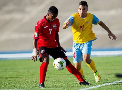 Photo: Trinidad and Tobago substitute Akeem Garcia invites Aruba defender Marcel Kock to dance in the CONCACAF Under-20 Championship. (Courtesy CONCACAF)