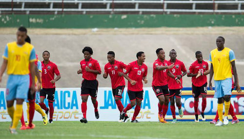Photo: Trinidad and Tobago national under-20 players celebrate a goal against Aruba in the CONCACAF Under-20 Championship. (Courtesy CONCACAF)