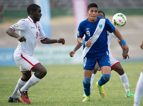 Photo: Trinidad and Tobago midfielder Neveal Hackshaw (left) tries to close down Guatemala star Mauro Portillo during the 2015 CONCACAF Under-20 Championships in Jamaica. (Courtesy CONCACAF)